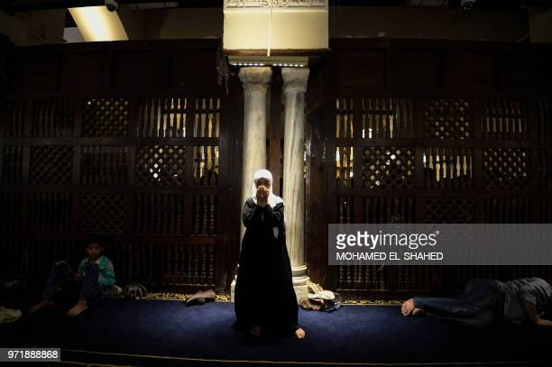 Muslim woman takes part in the evening prayers at Laylat alQadr or Night of Destiny during the holy fasting month of Ramadan at alAzhar mosque in the...
