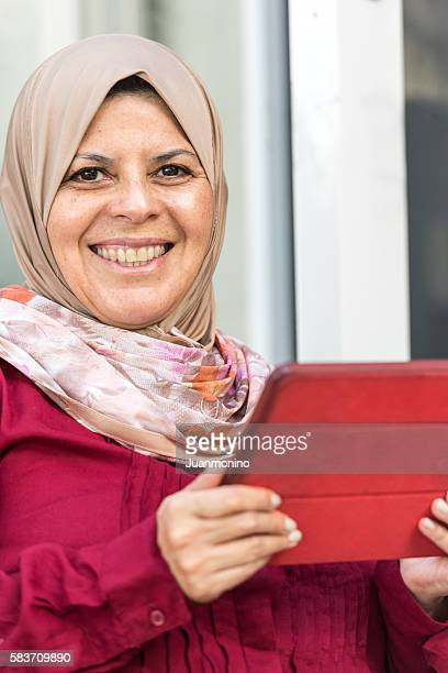 Muslim Woman using an Electronic Tablet
