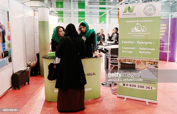 A Muslim woman visits an Islamic finance stand in the commercial space of the 31st annual meeting of the Muslims of France organised by the Union of...