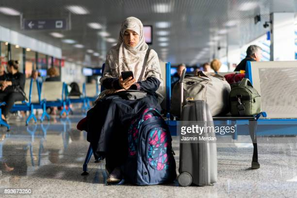 Muslim woman waiting on airport