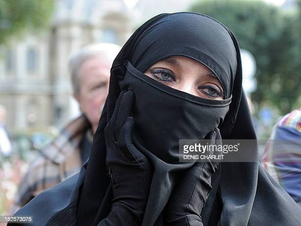 Muslim woman waits during an identity control, on September 22, 2012 near the prefecture of Lille, northern France, as police was deployed in several...