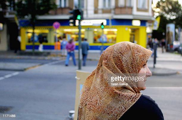 Muslim woman waits to cross a street October 10 2001 in Berlin's heavilyMuslim Neukoelln district Investigators are revealing that Germany has been a...