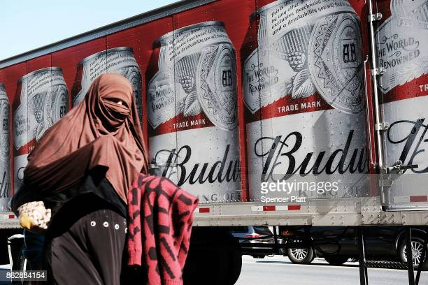 Muslim woman walks along Coney Island Avenue on October 18 2017 in New York City Coney Island Avenue a road that runs northsouth for a distance of...