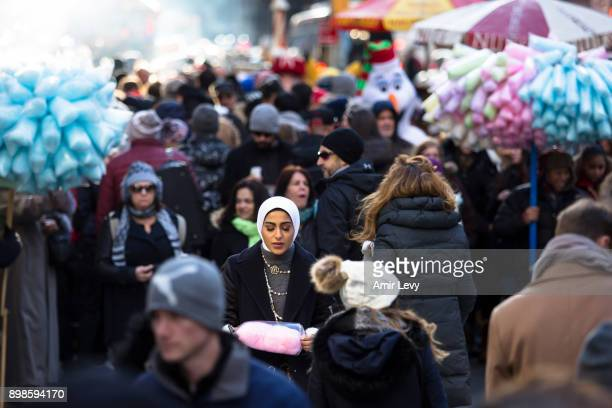 Muslim woman walks along Fifth Avenue on Christmas day on December 25 2017 in New York City Security in New York is on alert as thousand of tourists...