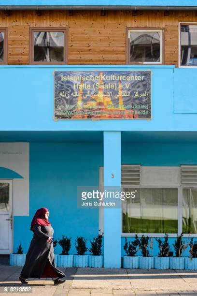 Muslim woman walks along the Muslim cultural center and mosque following a recent attack just before the beginning of the visit of Aydan Ozoguz...