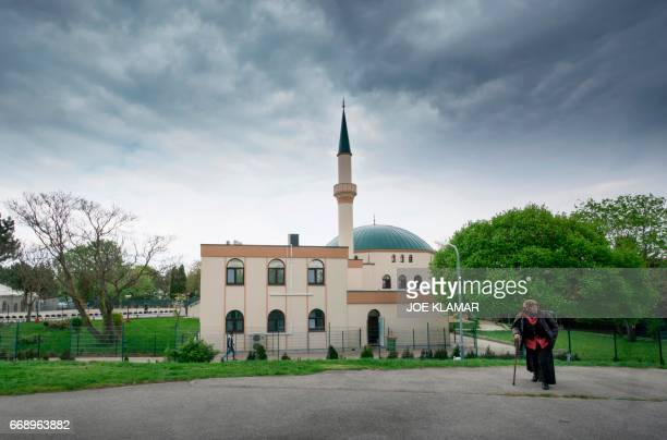 A Muslim woman walks by a mosque at Islam Centre of Vienna on April 14 2017 in Vienna Austria A debate is raging in Austria after a study suggested...