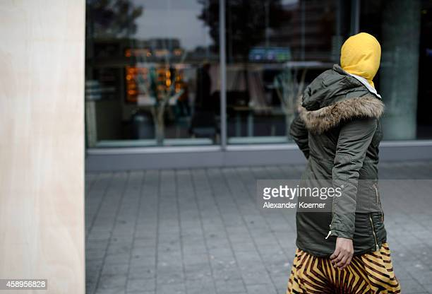A muslim woman walks by the glass facade of the Novotel Hotel at Hanover Central Trainstation on November 14 2014 in Hanover Germany The city of...