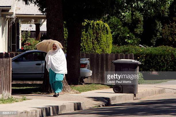 Muslim woman walks down the street on June 10 2005 in Lodi California Lodi the sleepy Northern California town has been hit with controversy after 5...