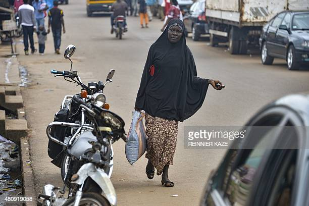 A Muslim woman walks in the Brituetterie district of Yaounde on July 16 2015 A northern region of Cameroon which has suffered frequent attacks by the...
