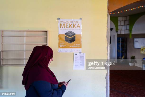Muslim woman walks inside the Muslim cultural center and mosque following a recent attack just before the beginning of the visit of Aydan Ozoguz...