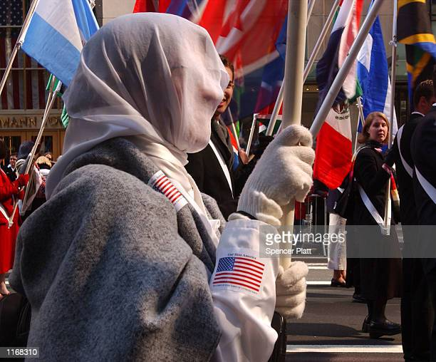 Muslim woman walks the parade route October 8 2001 during the Columbus Day Parade in New York City The city which is still counting its dead from the...