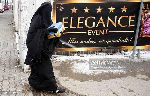 Muslim woman wearing a burqa arrives as Salafites are holding a benefit rally for Syrian Muslims on January 13 2013 in Berlin Two dozen members of...
