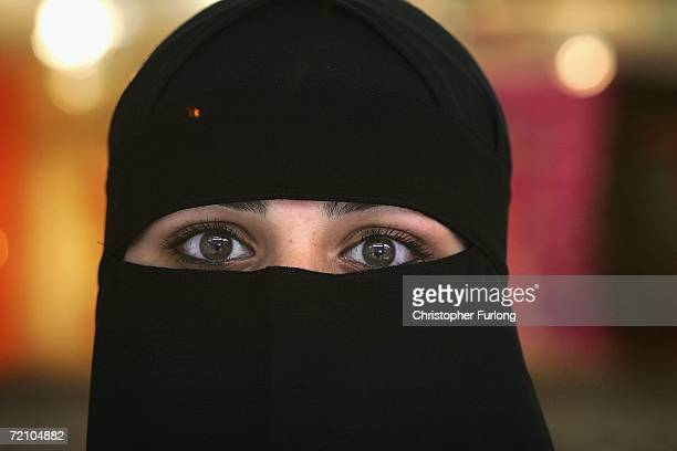 Muslim woman wearing a Niqab poses inside an Asian fashion shop in the British northern town of Blackburn, the constituency of Member of Parliament...