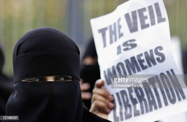 Muslim woman wearing a niqab veil protests outside Bangor Street Community centre where Leader of the House of Commons Jack Straw is holding one of...