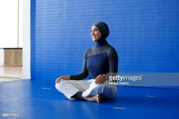 Muslim woman wearing hijab and jiu jitsu uniform
