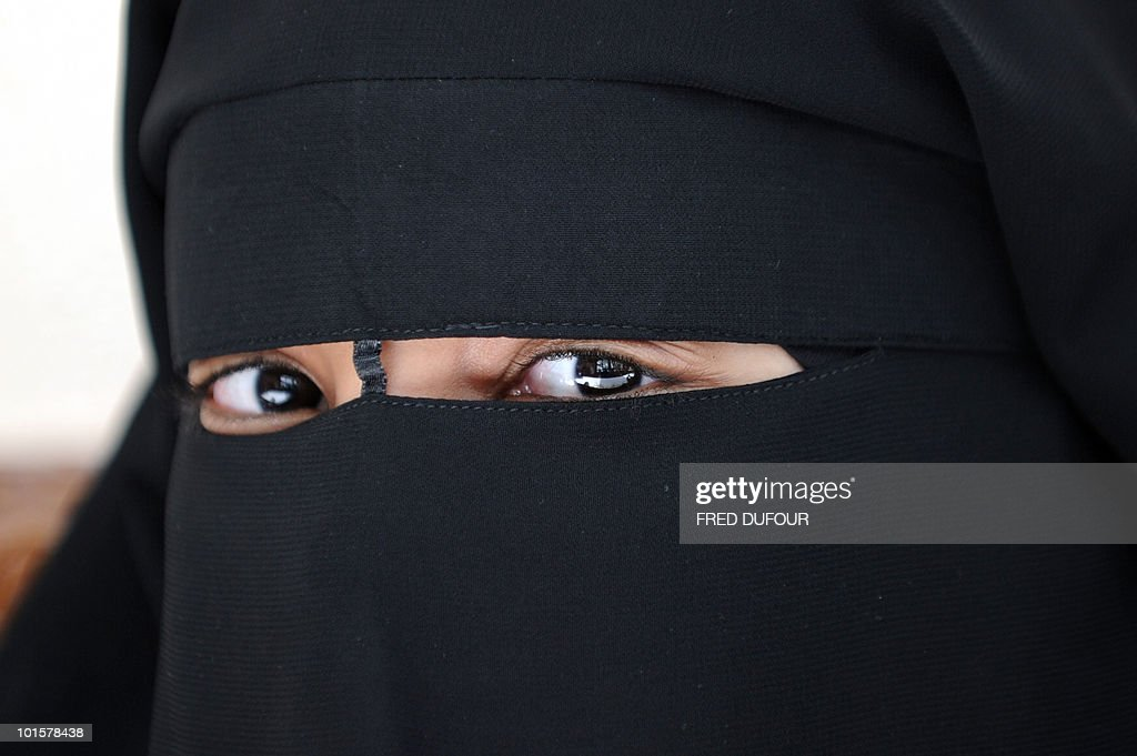 A Muslim woman wearing the niqab (veil which covers the body and leaves only a small strip for the eyes) poses during a meeting with Imam Ali El Moujahed on May 18, 2010 in Montreuil, outside Paris. The French parliament unanimously adopted on May 11, 2010 a resolution condemning the full-face Islamic veil as an affront to the nation's values.