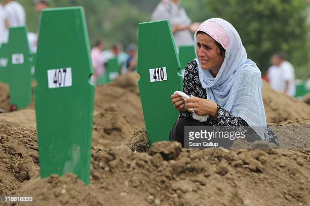 Muslim woman weeps at the fresh grave of one of 613 newlyidentified victims of the 1995 Srebrenica massacre during a mass funeral attended by tens of...