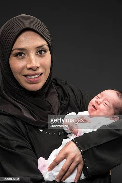 Muslim woman with her newborn daughter