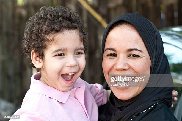 muslim woman with her son - syria stock pictures, royalty-free photos & images
