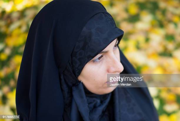 Muslim woman with hijab with camera in nature