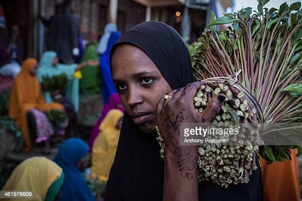 Muslim woman with qat leaves at the byg qat market in Aweday near harar ethiopia