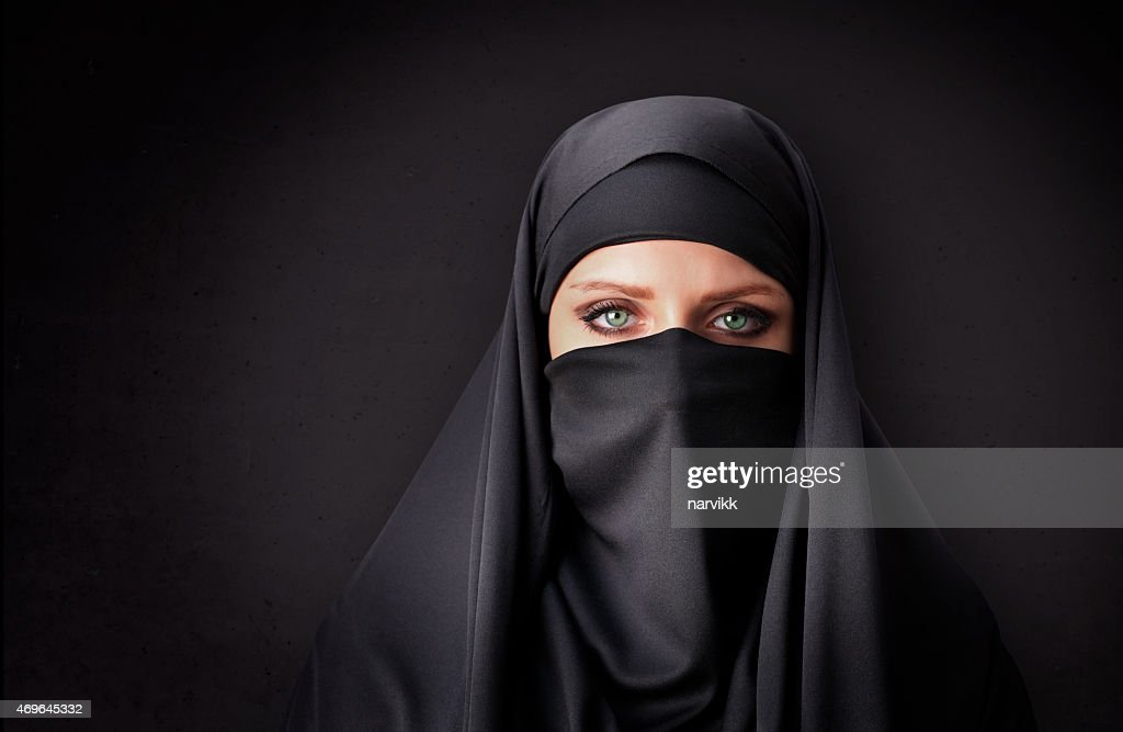 Muslim woman with traditional black veil : Stock Photo