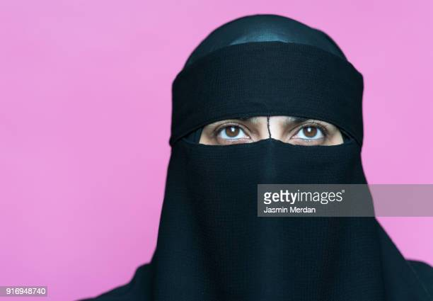 muslim woman with traditional black veil - burka fotografías e imágenes de stock