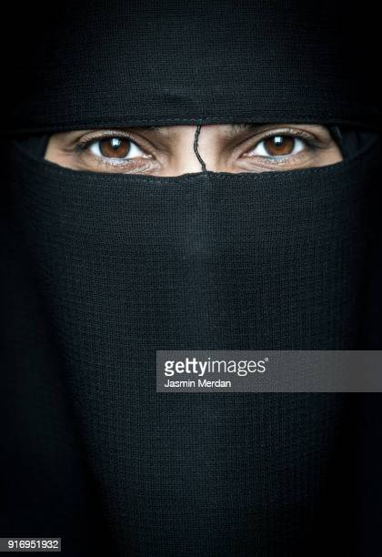 muslim woman with traditional black veil - niqab stock pictures, royalty-free photos & images