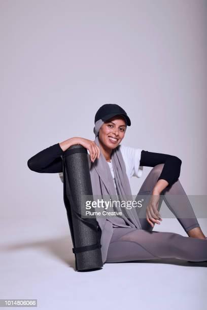 Muslim woman with yoga mat