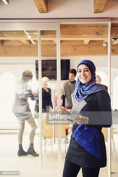 """muslim woman working in small fashion enterprise. - """"martine doucet"""" or martinedoucet stock pictures, royalty-free photos & images"""