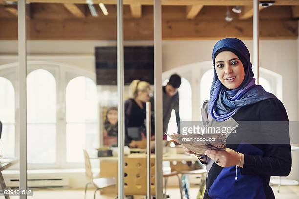 Muslim woman working in small fashion enterprise.