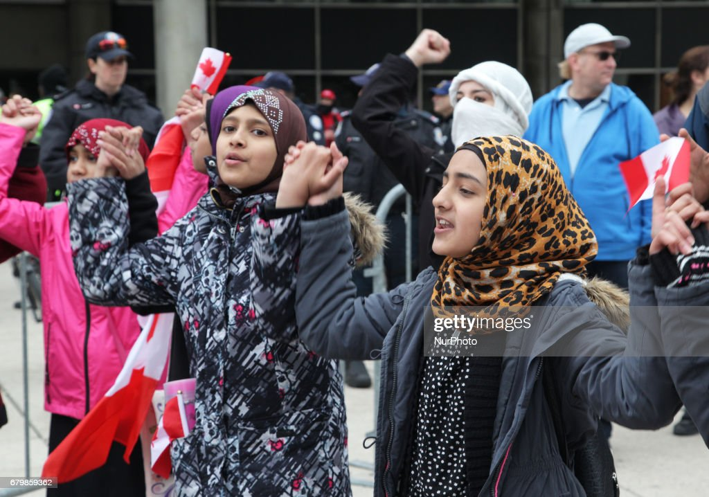 Muslim women and children form a 'circle of peace' during a rally against Islamophobia, White Supremacy & Fascism in downtown Toronto, Ontario, Canada, on May 06, 2017. Protesters clashed with anti-Muslim and fascist groups while hundreds of police officers were deployed to maintain control. Groups such as the Concerned Coalition of Canadian Citizens, the Soldiers of Odin, and the Jewish Defense League blame Muslims for unemployment, austerity and social cuts.