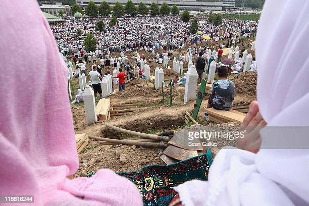 Muslim women attend the mass funeral for 613 newly-identified victims of the 1995 Srebrenica massacre attended by tens of thousands of mourners at...