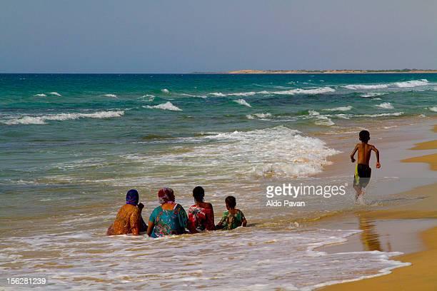 Muslim women bathing dressed in the Red Sea