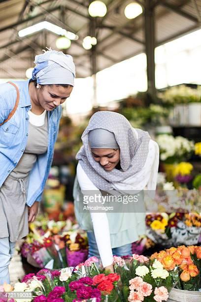 Muslim women buying flowers at a flower market.