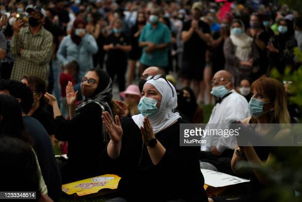 Muslim women clapping while listening to the speakers during a vigil to remember the four family members killed by a vehicle in a hate-motivated...