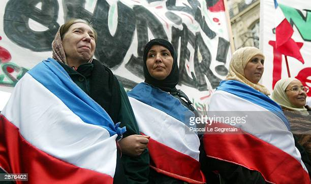 Muslim women demonstrate against the French proposal to bar Muslim women from wearing headscarves in state schools on January 17 2004 in Paris France...