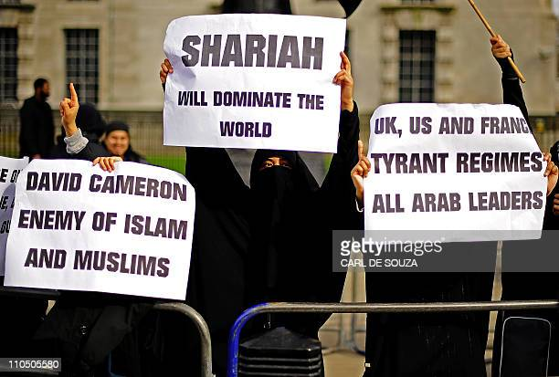 Muslim women demonstrate in favour of Sharia law during a protest outside 10 Downing Street in London on March 21 2011 British Prime Minister David...