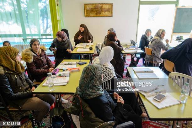 Muslim women from Syria take part in a German lesson in the Muslim cultural center and mosque as Aydan Ozoguz German Federal Commissioner for...