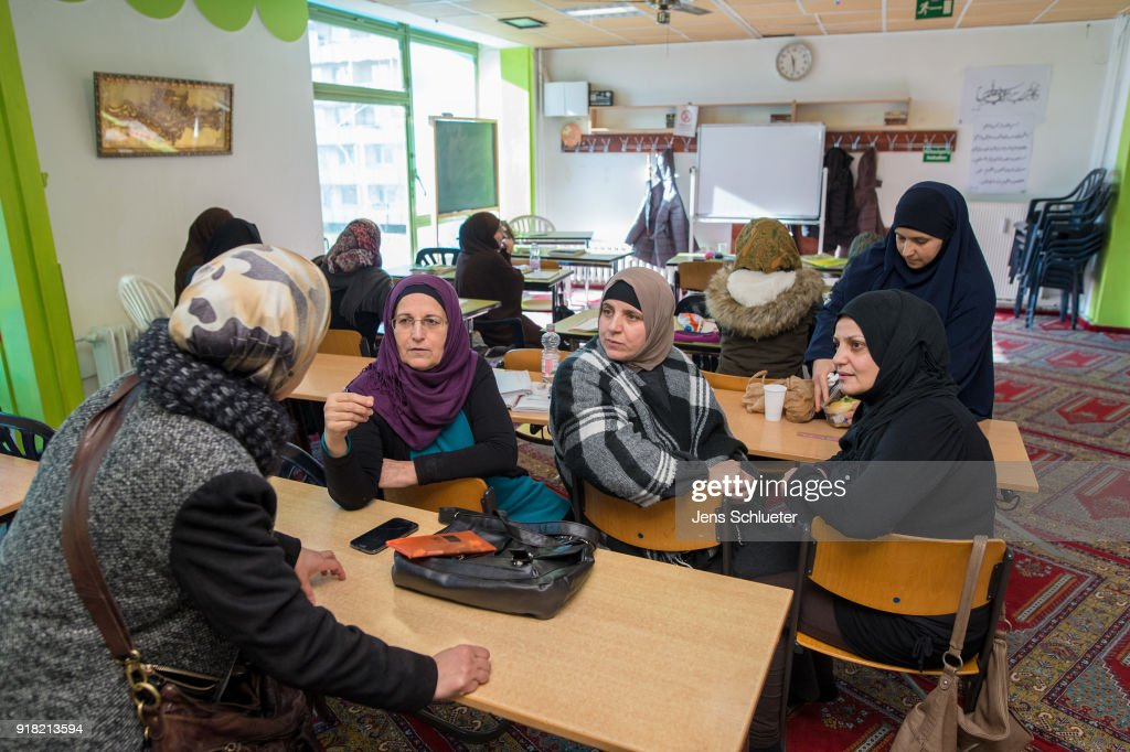 Muslim women from Syria take part in a German lesson in the Muslim cultural center and mosque as Aydan Ozoguz (not pictured), German Federal Commissioner for Immigration, Refugees and Integration visits the center and mosque following a recent attack on February 14, 2018 in Halle an der Saale, Germany. Shots possibly fired with an air gun from a nearby building injured a mosque member earlier this month, only a week after a similar incident. The center has been the target of attacks since 2015 in a city that struggles with right-wing extremism, which has become more virulent since over a million mostly Muslim refugees and migrants came to Germany in 2015-2016.