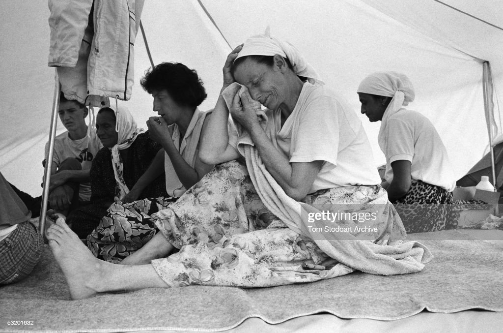 In July 1995 the worst case of genocide since World War II took place at Srebrenica in Bosnia. Over a period of five day Bosnian Serb army took control of the small spa town and separated Muslim males from their families. Over 7,000 men and boys were systematically murdered in the fields and valleys around the area. Muslim women grieve for their men folk killed by Serb soldiers while fleeing Srebrenica.