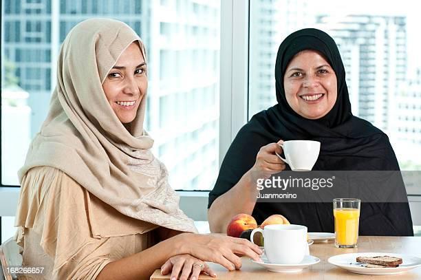 muslim women having breakfast - arab women fat stock pictures, royalty-free photos & images