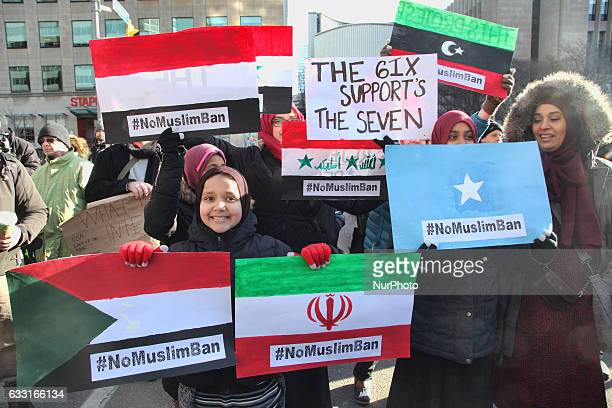 Muslim women hold signs with the flags of the banned countries during a massive protest against President Trump's travel ban outside of the US...