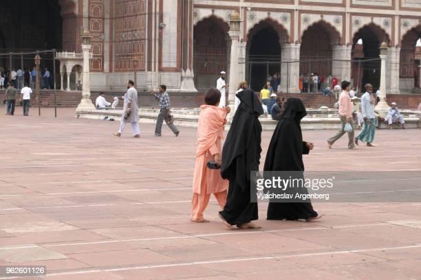 Muslim women in Jama Masjid mosque courtyard, Delhi, India