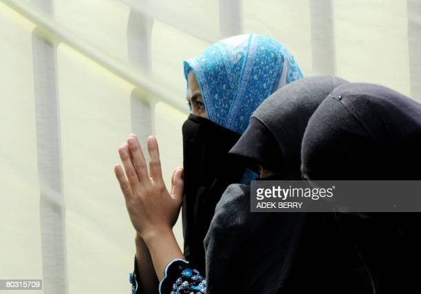 Muslim women listen to a preacher during mass as they pray for Prophet Mohammed at a park in Jakarta on March 20 2008 Muslim around the world...