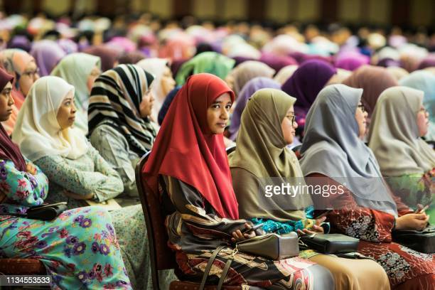 Muslim women listen to Brunei's Sultan Hassanal Bolkiah's speech during an event in Bandar Seri Begawan on April 3 2019 Brunei's sultan called for...