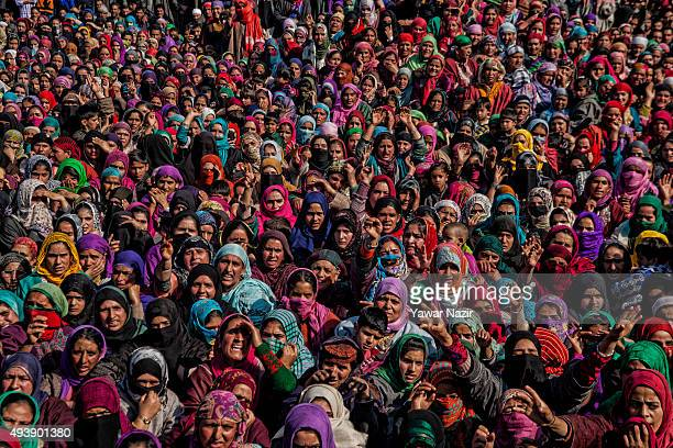 Muslim women Mourners attend the funeral of Adil Hussain Khandey, a local pro Kashmir rebel killed in a gun battle with the Indian government forces,...