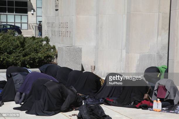 Muslim women perform prayers during a protest against US President Donald Trump's decision to launch airstrikes against Syria on April 8 2017 in...