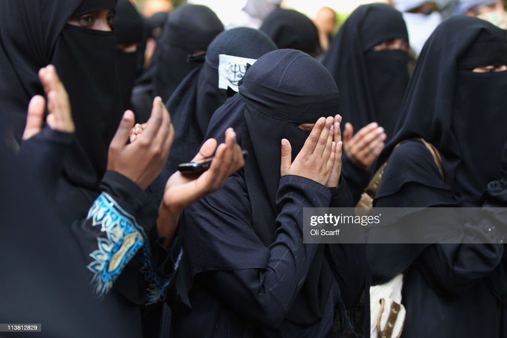 Muslim women pray during a protest against the killing of Osama bin Laden outside the US embassy in Mayfair on May 6, 2011 in London, England. The demonstration, which was called by radical Muslim cleric Anjem Choudary, was in close proximity to a rival protest by the English Defense League who were celebrating the death of the al-Queda leader.
