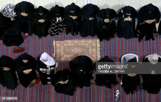 Muslim women pray in Kuwait City's Grand Mosque just before daybreak during Laylat alQadr or Night of Destiny during the holy month of Ramadan on...